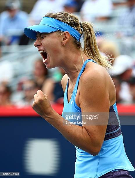 Maria Sharapova of Russia reacts after a point against Garbine Muguruza of Spain during the Rogers Cup at Uniprix Stadium on August 6 2014 in...