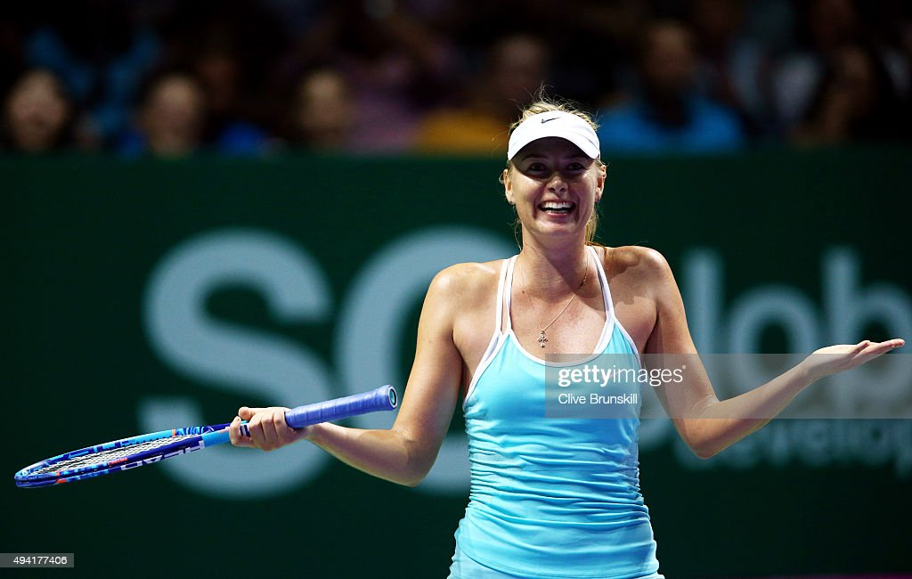<a gi-track='captionPersonalityLinkClicked' href=/galleries/search?phrase=Maria+Sharapova&family=editorial&specificpeople=157600 ng-click='$event.stopPropagation()'>Maria Sharapova</a> of Russia reacts after a three set victory againt Agnieszka Radwanska of Poland in a round robin match during the BNP Paribas WTA Finals at Singapore Sports Hub on October 25, 2015 in Singapore.