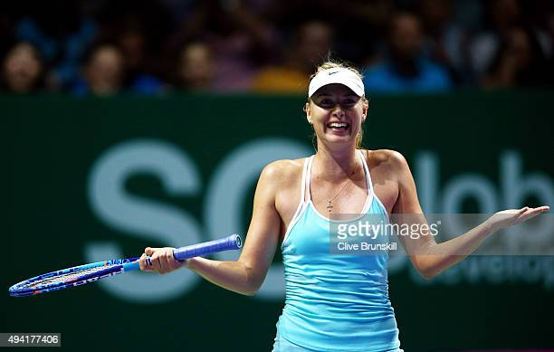 Maria Sharapova of Russia reacts after a three set victory againt Agnieszka Radwanska of Poland in a round robin match during the BNP Paribas WTA...