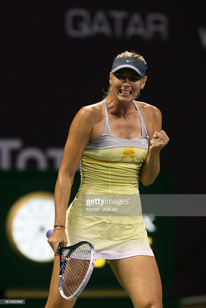 Maria Sharapova of Russia reacts after winning a point against Caroline Garcia of France during their match on the second day of the WTA Qatar Open in the capital Doha, on February 12, 2013.