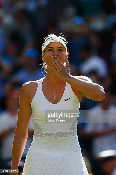 Maria Sharapova of Russia reacts after winning her Ladies' Singles first round match against Johanna Konta of Great Britain during day one of the...
