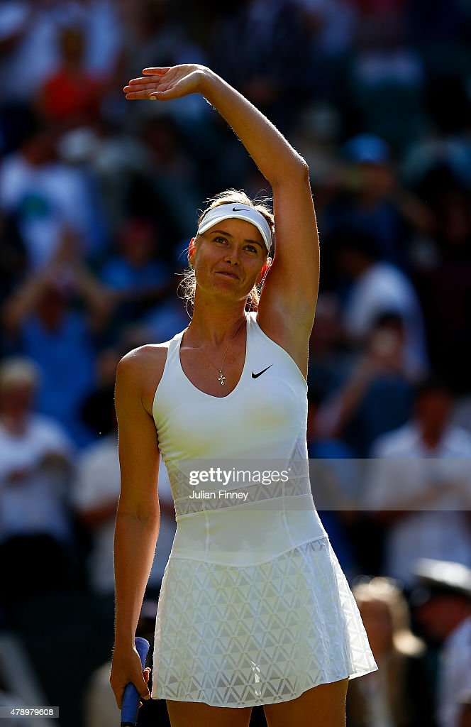 <a gi-track='captionPersonalityLinkClicked' href=/galleries/search?phrase=Maria+Sharapova&family=editorial&specificpeople=157600 ng-click='$event.stopPropagation()'>Maria Sharapova</a> of Russia reacts after winning her Ladies's Singles first round match against Johanna Konta of Great Britain during day one of the Wimbledon Lawn Tennis Championships at the All England Lawn Tennis and Croquet Club on June 29, 2015 in London, England.