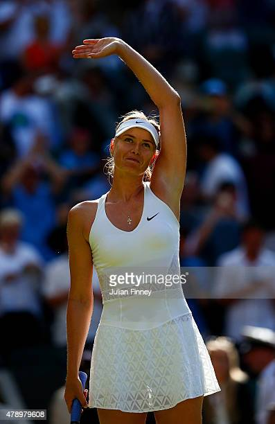 Maria Sharapova of Russia reacts after winning her Ladies's Singles first round match against Johanna Konta of Great Britain during day one of the...