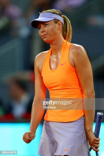 Maria Sharapova of Russia reacts during her match against Eugenie Bouchard of Canada on day three of the Mutua Madrid Open tennis at La Caja Magica...