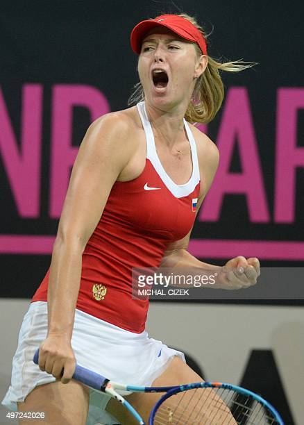 Maria Sharapova of Russia reacts during her match against Petra Kvitova of Czech Republic at the International Tennis Federation Fed Cup final match...