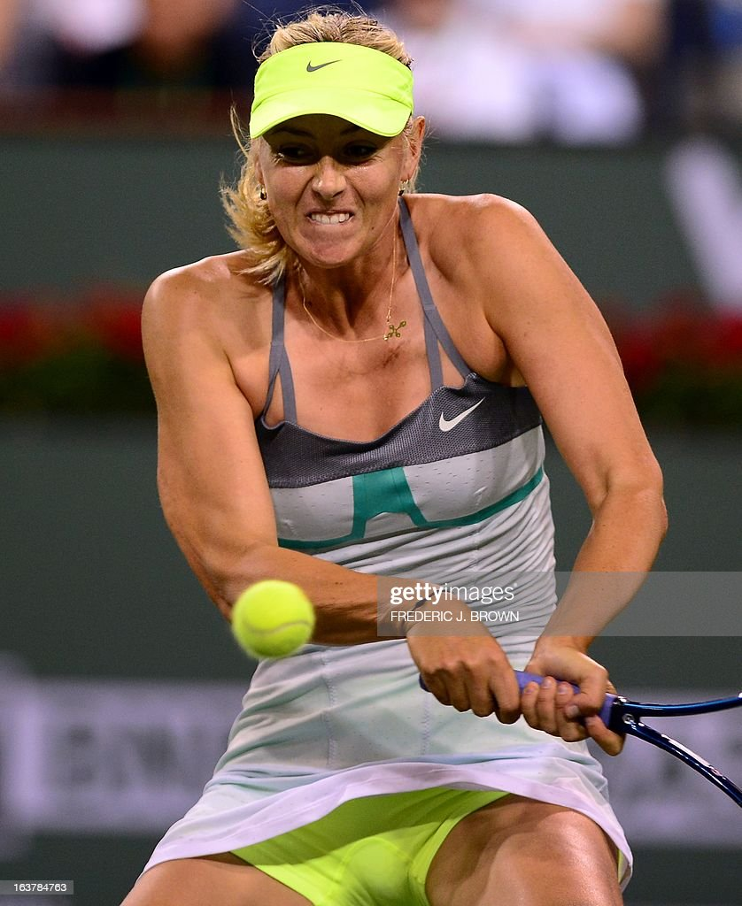 Maria Sharapova of Russia readies for a backhand return against compatriot Maria Kirilenko on March 15, 2013 in Indian Wells, California, during their semirfinal match at the BNP Paribas Open. AFP PHOTO/Frederic J. BROWN