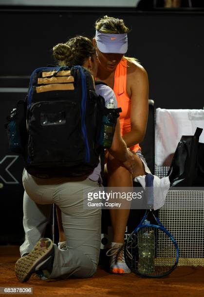 Maria Sharapova of Russia recieves treatment after pulling up with an injury during her second round match against Miriana LucicBaroni of Croatia in...