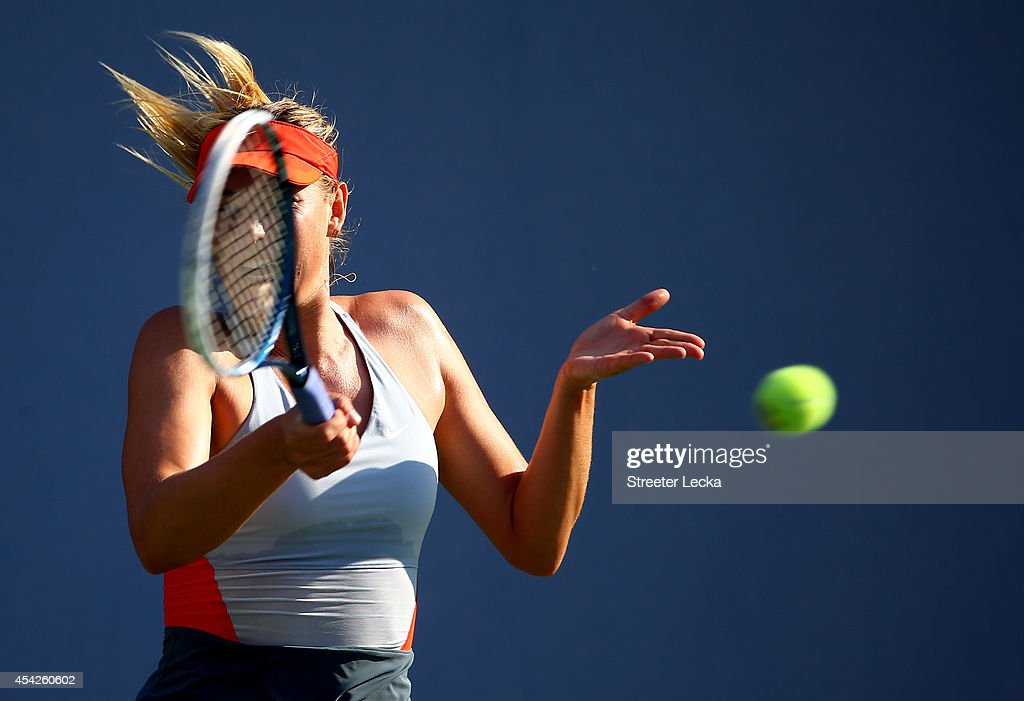 Maria Sharapova of Russia returns a shot against Alexandra Dulgheru of Romania during their women's singles second round match on Day Three of the 2014 US Open at the USTA Billie Jean King National Tennis Center on August 27, 2014 in the Flushing neighborhood of the Queens borough of New York City.