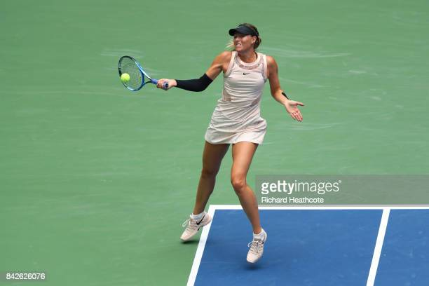 Maria Sharapova of Russia returns a shot against Anastasija Sevastova of Latvia during their Women's Singles fourth round match on Day Seven of the...