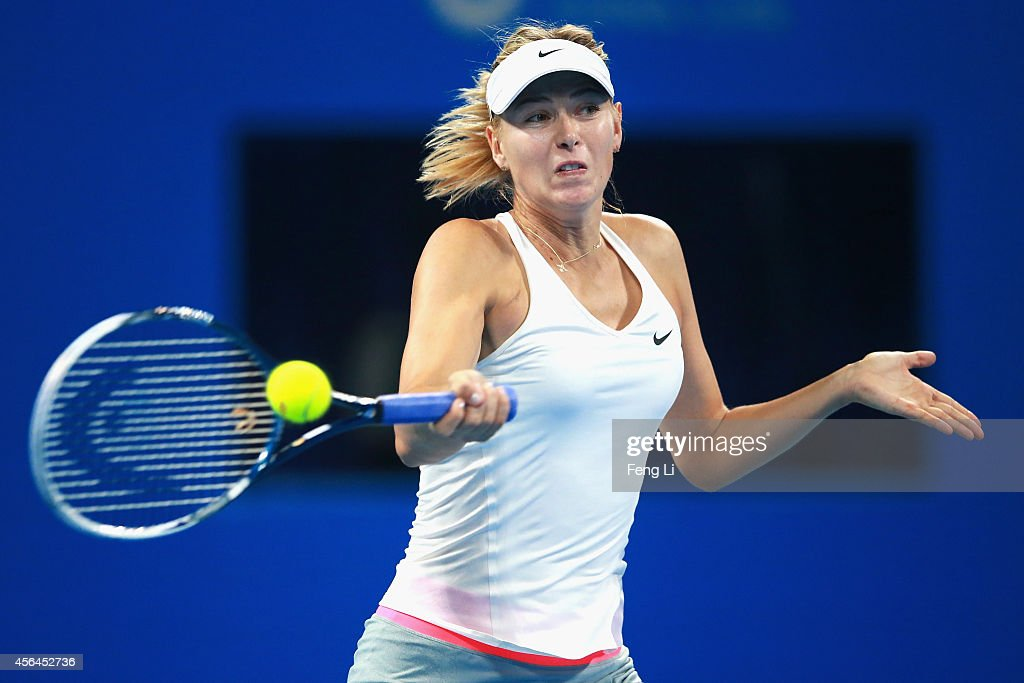 Maria Sharapova of Russia returns a shot against Carla Suarez Navarro of Spain during day five of the China Open at the China National Tennis Center on October 1, 2014 in Beijing, China.