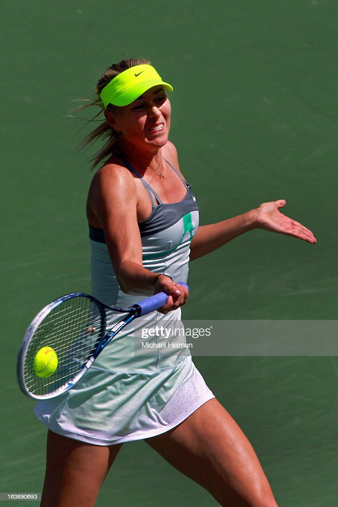 Maria Sharapova of Russia returns a shot against Caroline Wozniacki of Denmark during the women's final match of the 2013 BNP Paribas Open at the Indian Wells Tennis Garden on March 17, 2013 in Indian Wells, California.