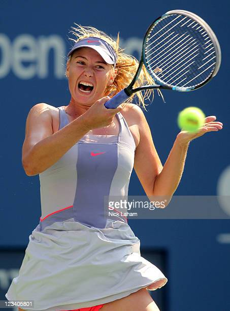 Maria Sharapova of Russia returns a shot against Flavia Pennetta of Italy during Day Five of the 2011 US Open at the USTA Billie Jean King National...