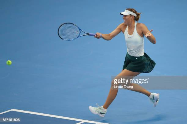 Maria Sharapova of Russia returns a shot against Simona Halep of Romania during the Women's singles 3rd round on day five of 2017 China Open at the...