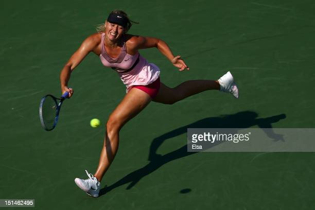 Maria Sharapova of Russia returns a shot during her women's singles semifinal match against Victoria Azarenka of Belarus on Day Twelve of the 2012 US...