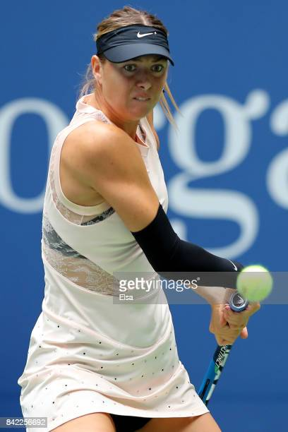 Maria Sharapova of Russia returns a shot during her women's singles fourth round match against Anastasija Sevastova of Latvia on Day Seven of the...