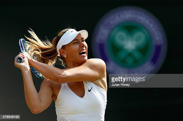 Maria Sharapova of Russia returns a shot in her Ladies' Singles Third Round match against IrinaCamelia Begu of Romania during day five of the...