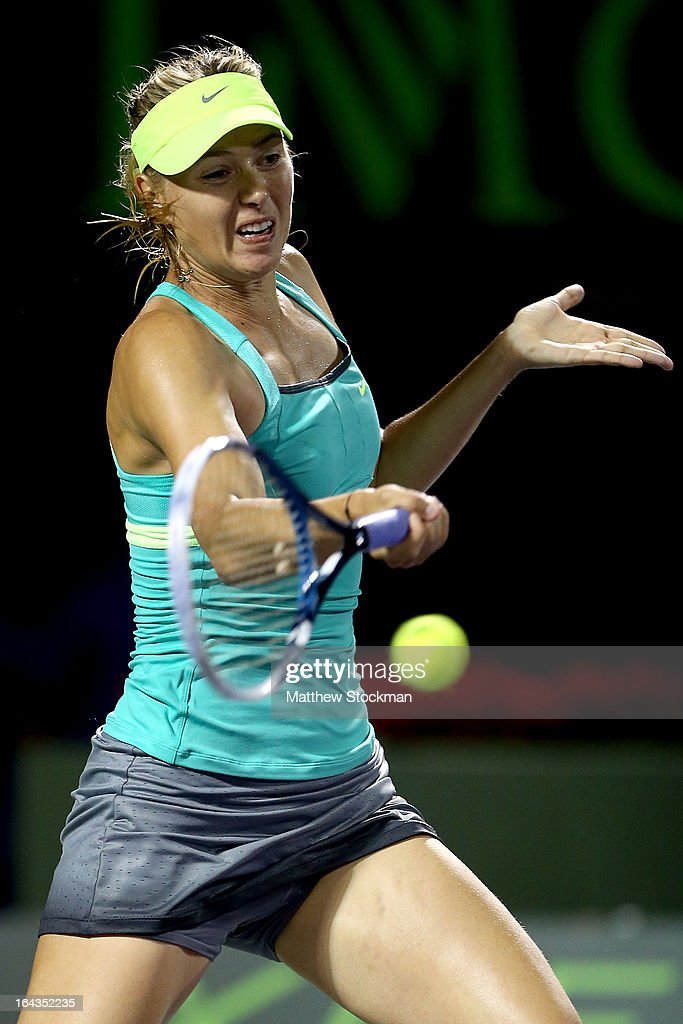 <a gi-track='captionPersonalityLinkClicked' href=/galleries/search?phrase=Maria+Sharapova&family=editorial&specificpeople=157600 ng-click='$event.stopPropagation()'>Maria Sharapova</a> of Russia returns a shot to Eugenie Bouchard of Canada during the Sony Open at Crandon Park Tennis Center on March 22, 2013 in Key Biscayne, Florida.