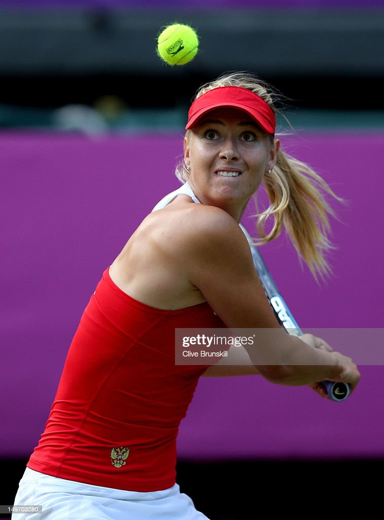 <a gi-track='captionPersonalityLinkClicked' href=/galleries/search?phrase=Maria+Sharapova&family=editorial&specificpeople=157600 ng-click='$event.stopPropagation()'>Maria Sharapova</a> of Russia returns a shot to Kim Clijsters of Belgium during the Quarterfinals of Women's Singles Tennis on Day 6 of the London 2012 Olympic Games at Wimbledon on August 2, 2012 in London, England.