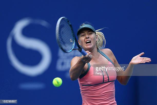 Maria Sharapova of Russia returns a shot to Sorana Cirstea of Romania during the Day 5 of China Open at the China National Tennis Center on October 3...