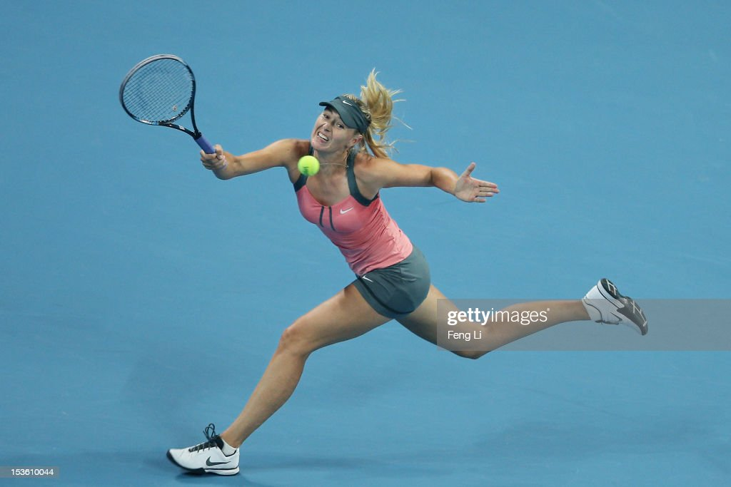 <a gi-track='captionPersonalityLinkClicked' href=/galleries/search?phrase=Maria+Sharapova&family=editorial&specificpeople=157600 ng-click='$event.stopPropagation()'>Maria Sharapova</a> of Russia returns a shot to Victoria Azarenka of Belarus during the Women's Single Final of the China Open at the China National Tennis Center on October 7, 2012 in Beijing, China.