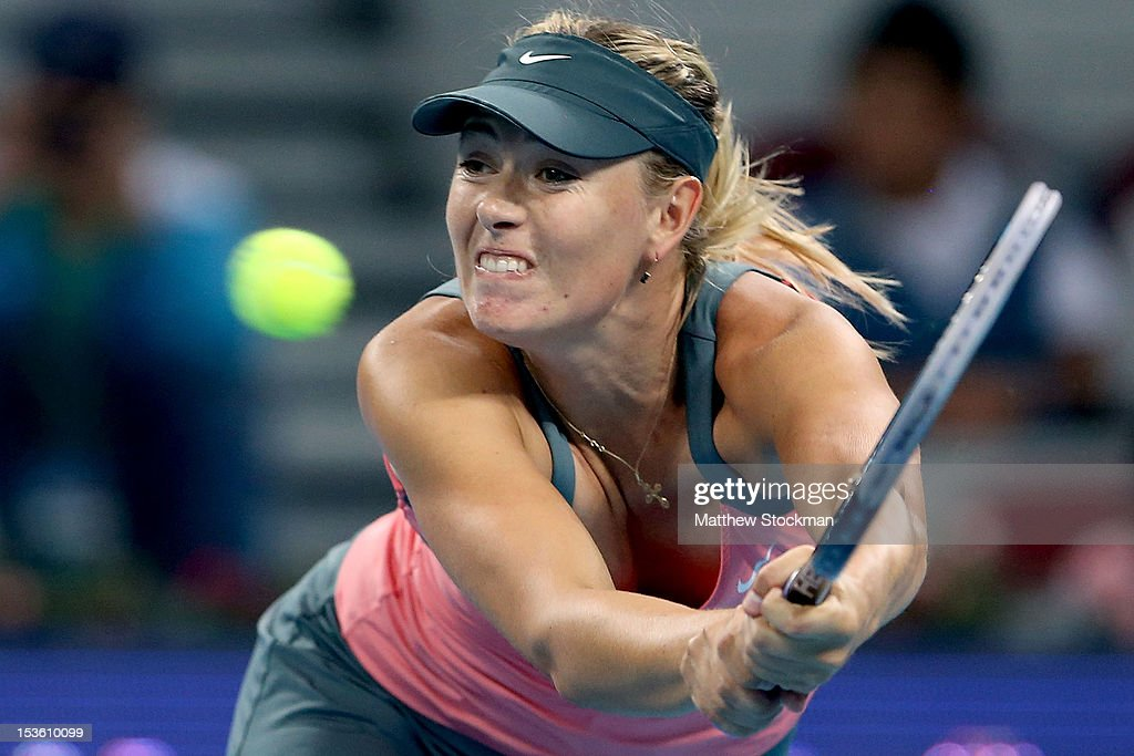 <a gi-track='captionPersonalityLinkClicked' href=/galleries/search?phrase=Maria+Sharapova&family=editorial&specificpeople=157600 ng-click='$event.stopPropagation()'>Maria Sharapova</a> of Russia returns a shot to Victoria Azarenka of Belarus during the final of the China Open at the China National Tennis Center on October 7, 2012 in Beijing, China.