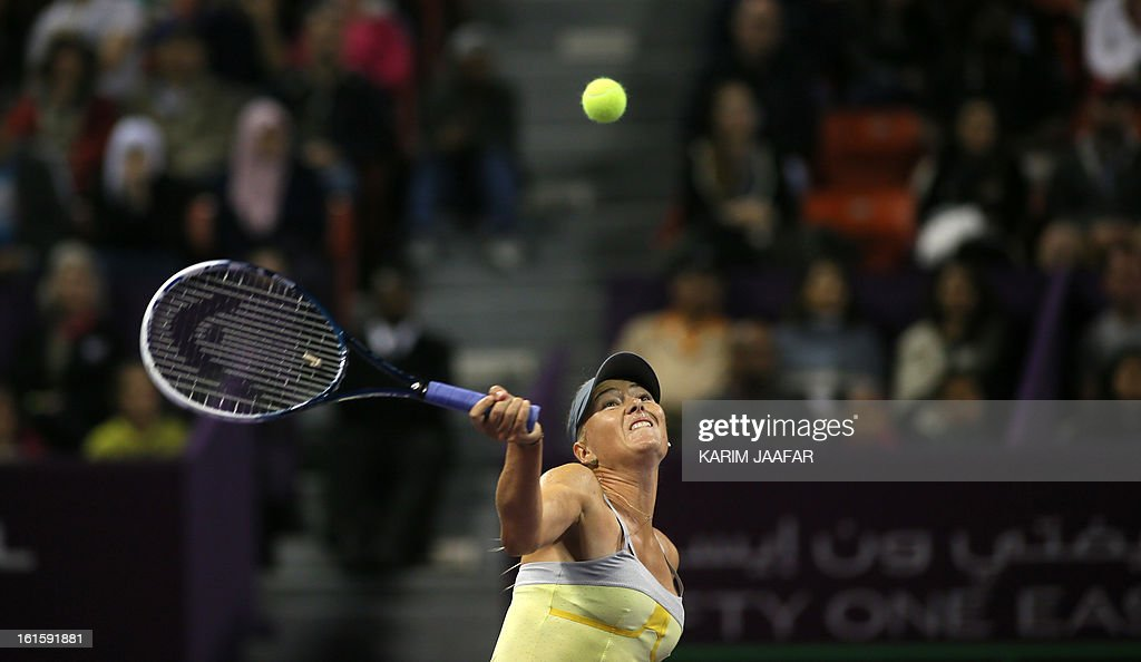 Maria Sharapova of Russia returns the ball to Caroline Garcia of France during their match on the second day of the WTA Qatar Open in the capital Doha, on February 12, 2013. AFP PHOTO / AL-WATAN DOHA / KARIM JAAFAR == QATAR OUT ==