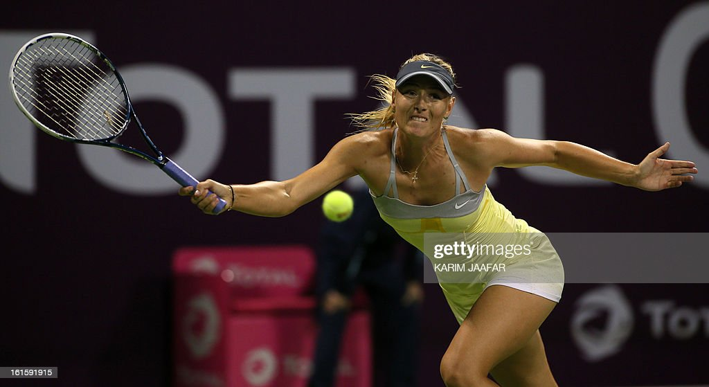 Maria Sharapova of Russia returns the ball to Caroline Garcia of France during their match on the second day of the WTA Qatar Open in the capital Doha, on February 12, 2013.