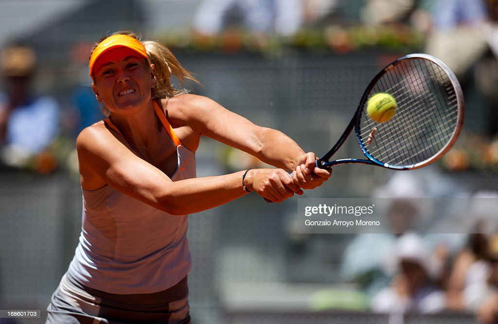 Maria Sharapova of Russia runs to play a doublehanded backhand to Serena Williams of the US during the final match on day nine of the Mutua Madrid Open tennis tournament at the Caja Magica on May 12, 2013 in Madrid, Spain.