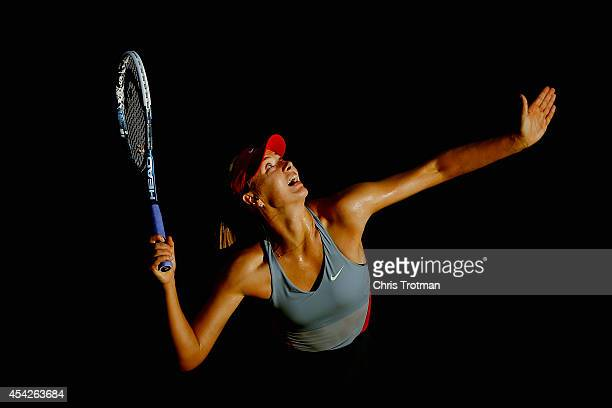 Maria Sharapova of Russia serves against Alexandra Dulgheru of Romania during their women's singles second round match on Day Three of the 2014 US...