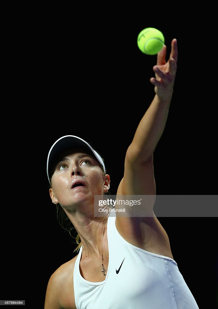 Maria Sharapova of Russia serves against Caroline Wozniacki of Denmark in their round robin match during the BNP Paribas WTA Finals at Singapore Sports Hub on October 21, 2014 in Singapore.