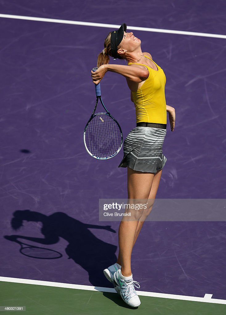 Maria Sharapova of Russia serves against Kirsten Flipkens of Belgium during their fourth round match during day 8 at the Sony Open at Crandon Park Tennis Center on March 24, 2014 in Key Biscayne, Florida.