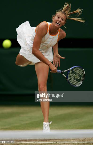 Maria Sharapova of Russia serves against Venus Williams of USA during the tenth day of the Wimbledon Lawn Tennis Championship on June 30 2005 at the...