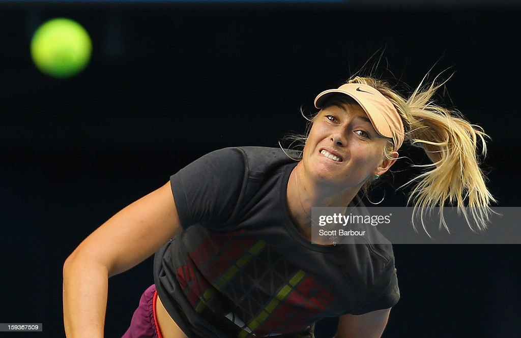 Maria Sharapova of Russia serves during a practice session ahead of the 2013 Australian Open at Melbourne Park on January 13, 2013 in Melbourne, Australia.