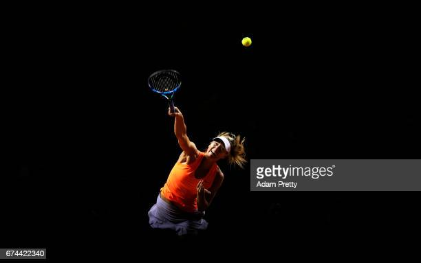 Maria Sharapova of Russia serves during her match against Anett Kontaveit of Estonia during the Porsche Tennis Grand Prix at Porsche Arena on April...