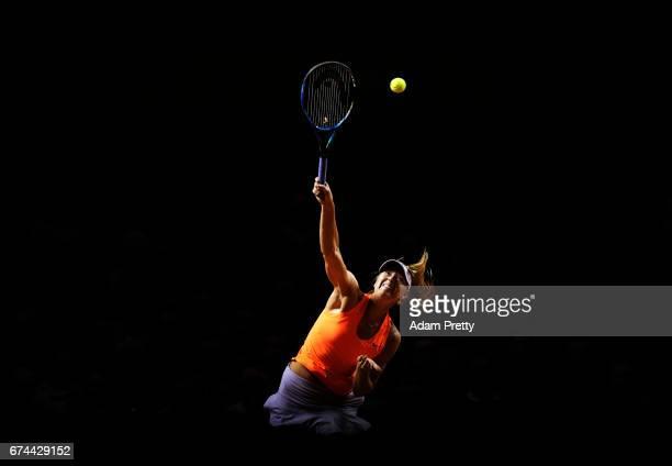 Maria Sharapova of Russia serves during her match against Anett Kontaveit of Estonia during the Porsche Tennis Grand Prix at Porsche Arena on April...