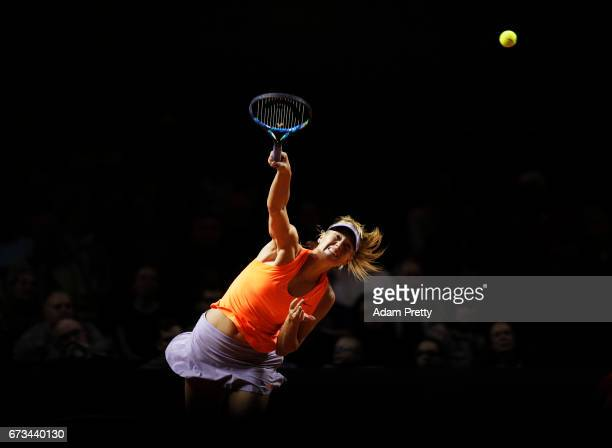 Maria Sharapova of Russia serves during her match against Roberta Vinci of Italy during the Porsche Tennis Grand Prix at Porsche Arena on April 26...
