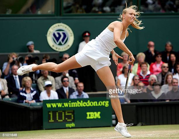 Maria Sharapova of Russia serves during the ladies final match against Serena Williams of USA at the Wimbledon Lawn Tennis Championship on July 3...