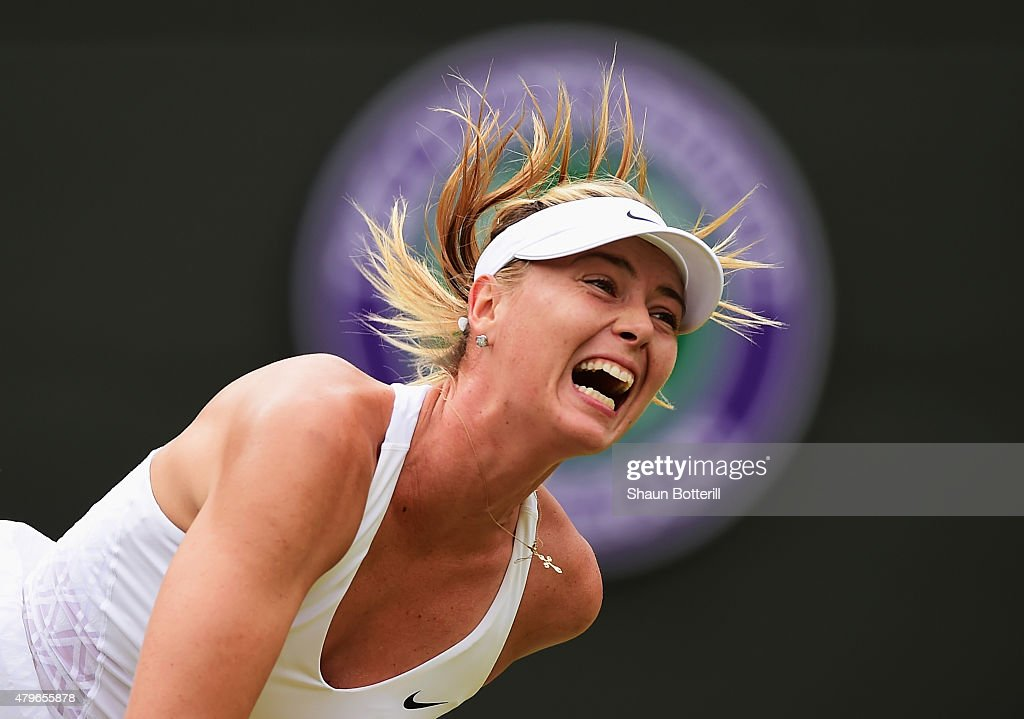 <a gi-track='captionPersonalityLinkClicked' href=/galleries/search?phrase=Maria+Sharapova&family=editorial&specificpeople=157600 ng-click='$event.stopPropagation()'>Maria Sharapova</a> of Russia serves in her Ladies' Singles Fourth Round match against Zarina Diyas of Kazakhstan during day seven of the Wimbledon Lawn Tennis Championships at the All England Lawn Tennis and Croquet Club on July 6, 2015 in London, England.