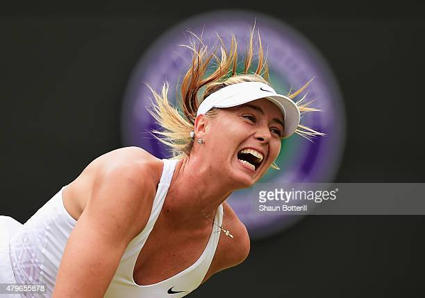 Maria Sharapova of Russia serves in her Ladies' Singles Fourth Round match against Zarina Diyas of Kazakhstan during day seven of the Wimbledon Lawn...