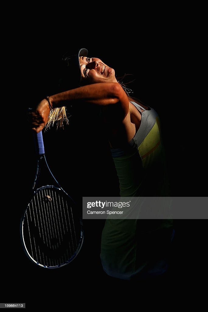 <a gi-track='captionPersonalityLinkClicked' href=/galleries/search?phrase=Maria+Sharapova&family=editorial&specificpeople=157600 ng-click='$event.stopPropagation()'>Maria Sharapova</a> of Russia serves in her Quarterfinal match against Ekaterina Makarova of Russia during day nine of the 2013 Australian Open at Melbourne Park on January 22, 2013 in Melbourne, Australia.