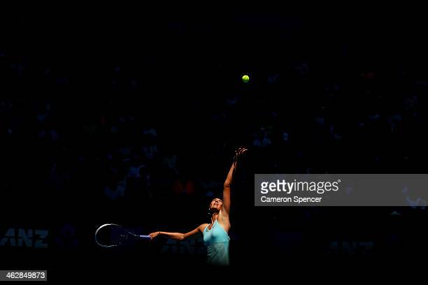 Maria Sharapova of Russia serves in her second round match against Karin Knapp of Italy during day four of the 2014 Australian Open at Melbourne Park...