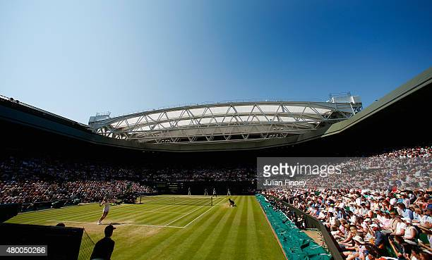 Maria Sharapova of Russia serves in the Ladies Singles Semi Final match against Serena Williams of the United States during day ten of the Wimbledon...