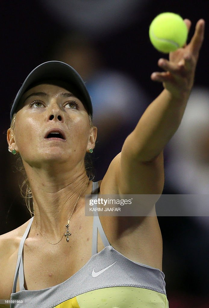 Maria Sharapova of Russia serves the ball to Caroline Garcia of France during their match on the second day of the WTA Qatar Open in the capital Doha, on February 12, 2013.