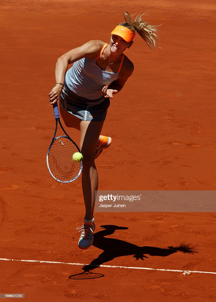 Maria Sharapova of Russia serves the ball to Serena Williams of the US during the final match on day nine of the Mutua Madrid Open tennis tournament at the Caja Magica on May 12, 2013 in Madrid, Spain.