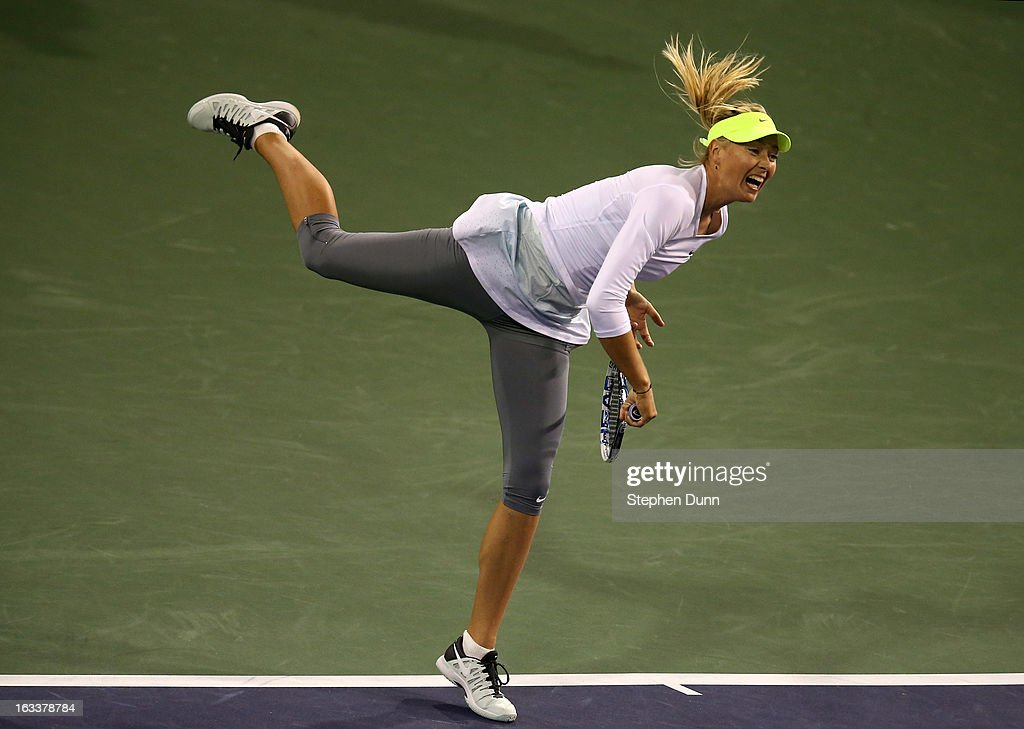 <a gi-track='captionPersonalityLinkClicked' href=/galleries/search?phrase=Maria+Sharapova&family=editorial&specificpeople=157600 ng-click='$event.stopPropagation()'>Maria Sharapova</a> of Russia serves to Francesca Schiavone of Italy during day 3 of the BNP Paribas Open at Indian Wells Tennis Garden on March 8, 2013 in Indian Wells, California.
