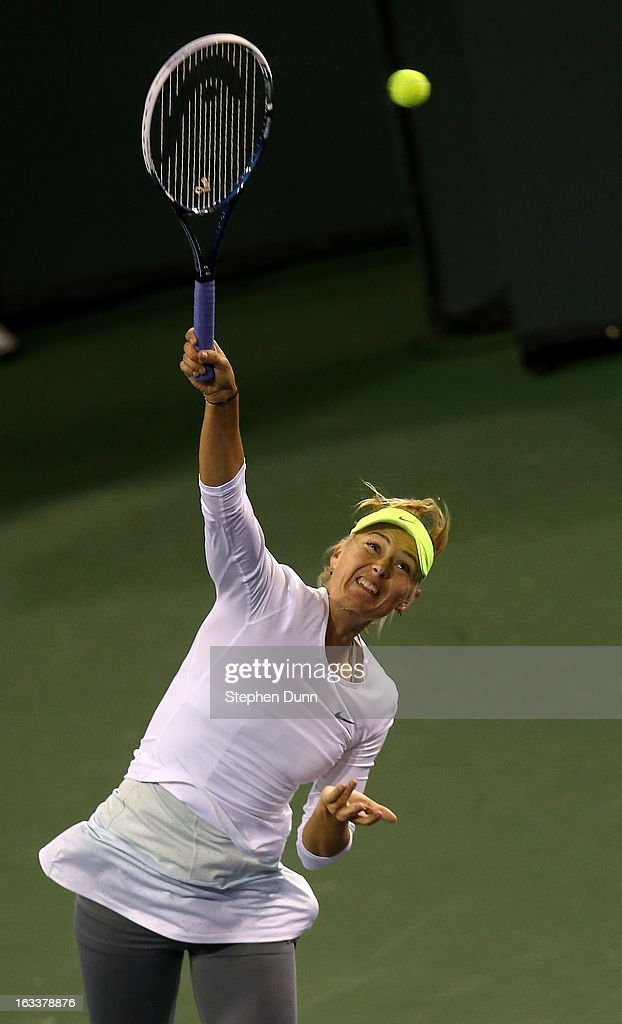 Maria Sharapova of Russia serves to Francesca Schiavone of Italy during day 3 of the BNP Paribas Open at Indian Wells Tennis Garden on March 8, 2013 in Indian Wells, California.