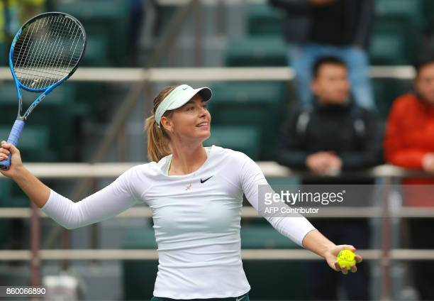 Maria Sharapova of Russia serves to IrinaCamelia Begu of Romania during their women's singles first round match at the WTA Tianjin Open tennis...