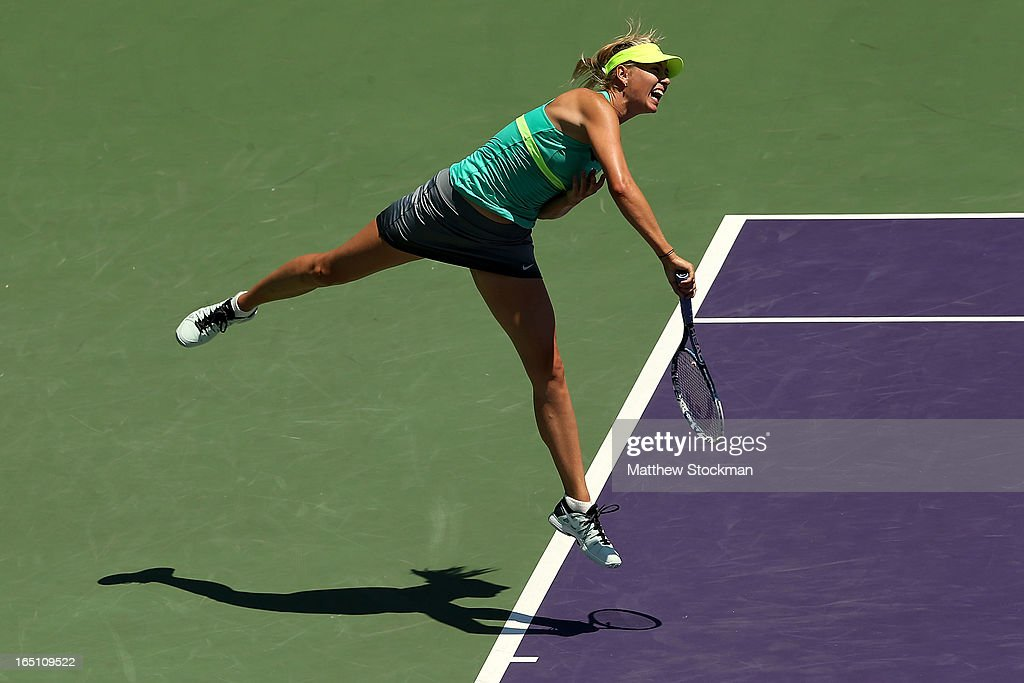 Maria Sharapova of Russia serves to Serena Williams during the final of the Sony Open at Crandon Park Tennis Center on March 30, 2013 in Key Biscayne, Florida.
