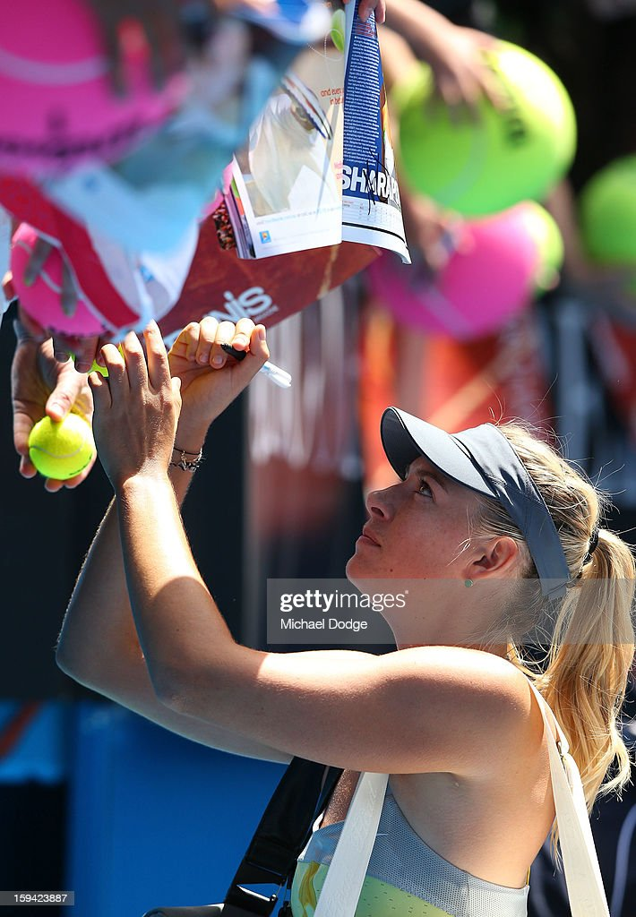 <a gi-track='captionPersonalityLinkClicked' href=/galleries/search?phrase=Maria+Sharapova&family=editorial&specificpeople=157600 ng-click='$event.stopPropagation()'>Maria Sharapova</a> of Russia signs autographs after winning her first round match against Olga Puchkova of Russia during day one of the 2013 Australian Open at Melbourne Park on January 14, 2013 in Melbourne, Australia.