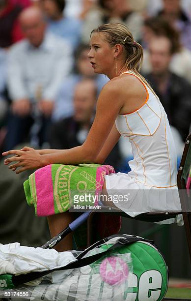 Maria Sharapova of Russia sits down at the change of ends against Venus Williams of USA during the tenth day of the Wimbledon Lawn Tennis...